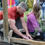 Planting a garden bed at a space grant site