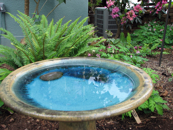 birdbath in a naturescaped yard