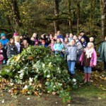 children remove invasive plants from Oxbow