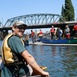 volunteers prepare to head out on kayaks