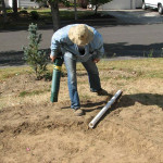 installing the overflow pipe in the rain garden