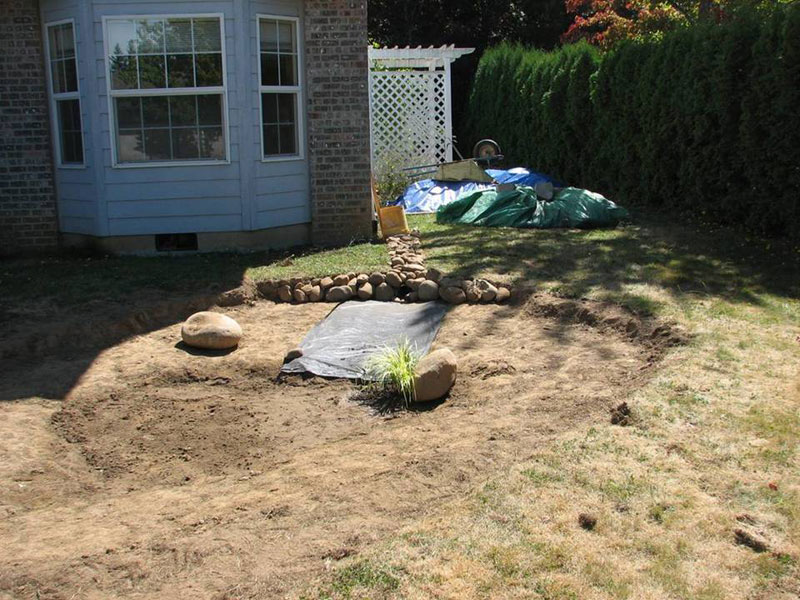 rock is added to the rain garden inlet