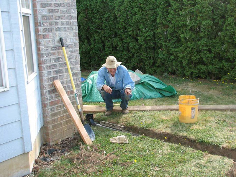 installing pipe from downspout to rain garden