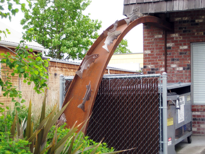 downspout art with swimming salmon