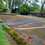 speed bump redirecting stormwater, with arrow