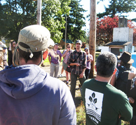 Rowan explains the irrigation system at Headwaters Farm to NIFTI Tour participants