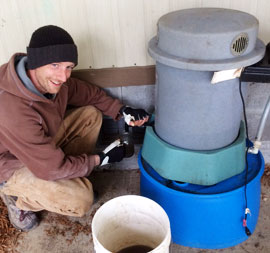 Pete from Udan Farm, pouring compost tea