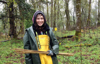 A volunteer at a restoration project