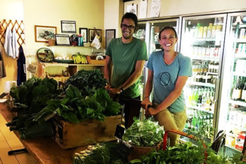 Brindley and Spencer of Tanager Farm selling their CSA shares at a neighborhood market
