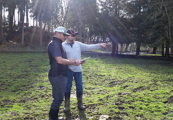 Jeremy and a landowner discussing pasture management