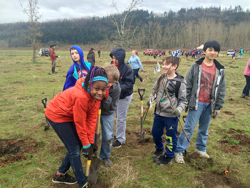 students planting at a grant project site