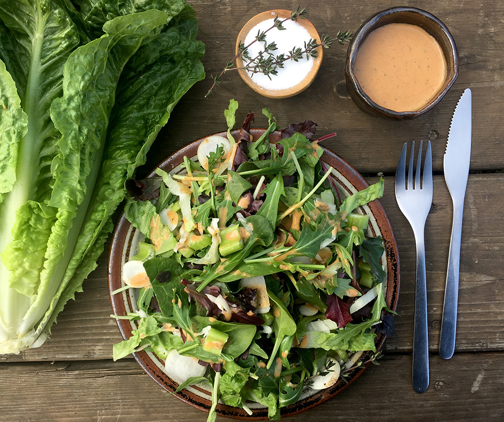 greens and a salad dressing